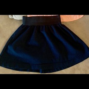 Navy mini skirt by Miley Cyrus.